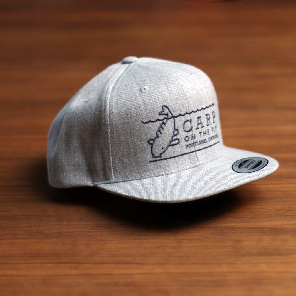 Heather flatbill snapback Promotional cap sold by Brewery Outfitters