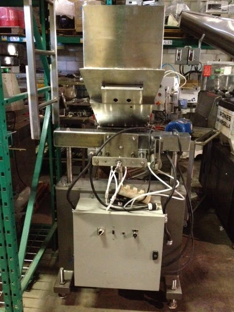 Automatic 4 Piston filler + Jacketed Tank Bottle filler sold by Aevos Equipment