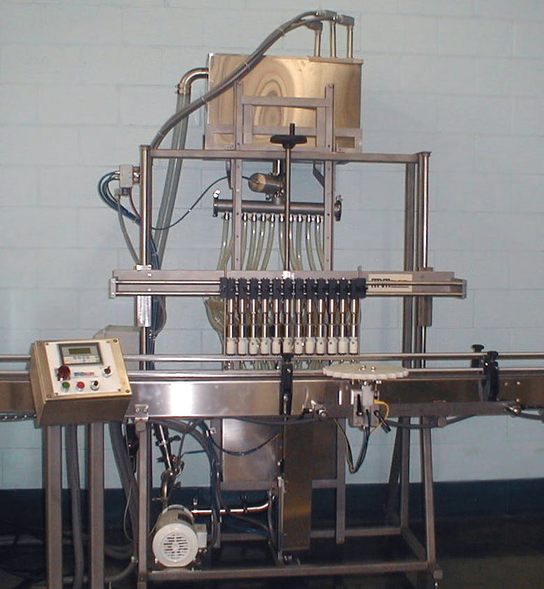 MRM Elgine Inline Bottle filler sold by MRM Elgin - Cozzoli Machine Company