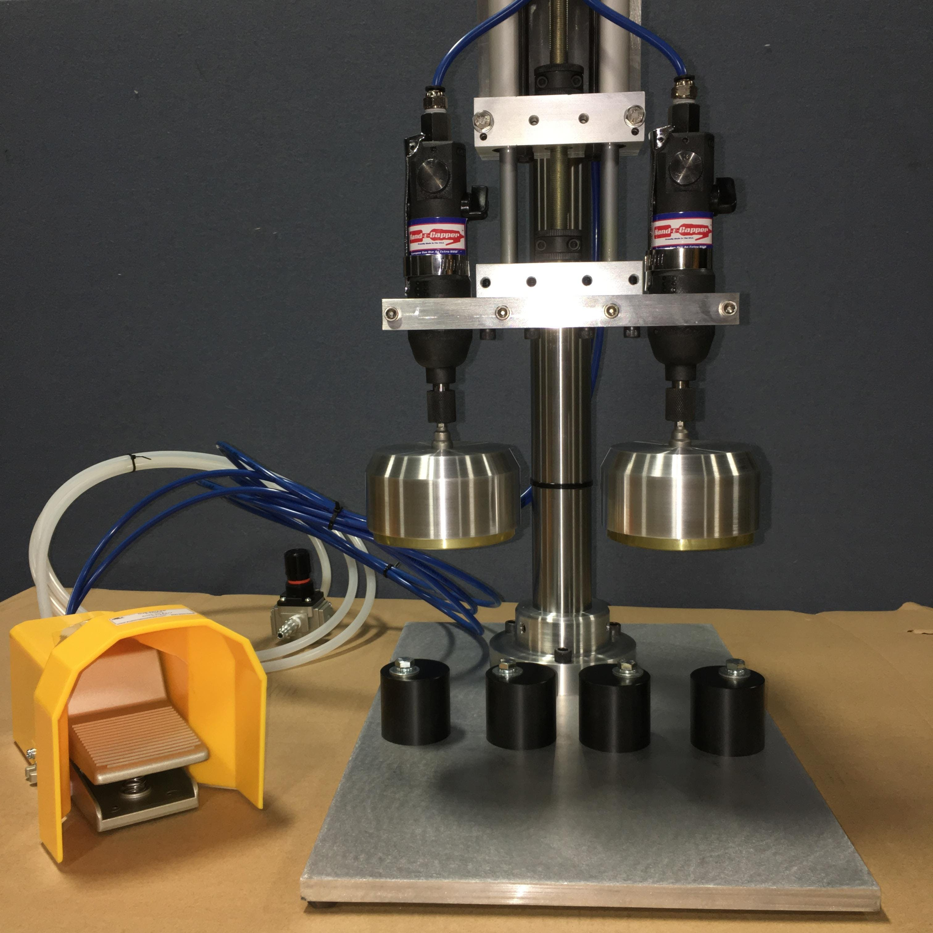 Hand-E-Capper Model V2 Dual Head Bench Top Cap Tightener Cap tightener sold by Hand-E-Capper LLC.