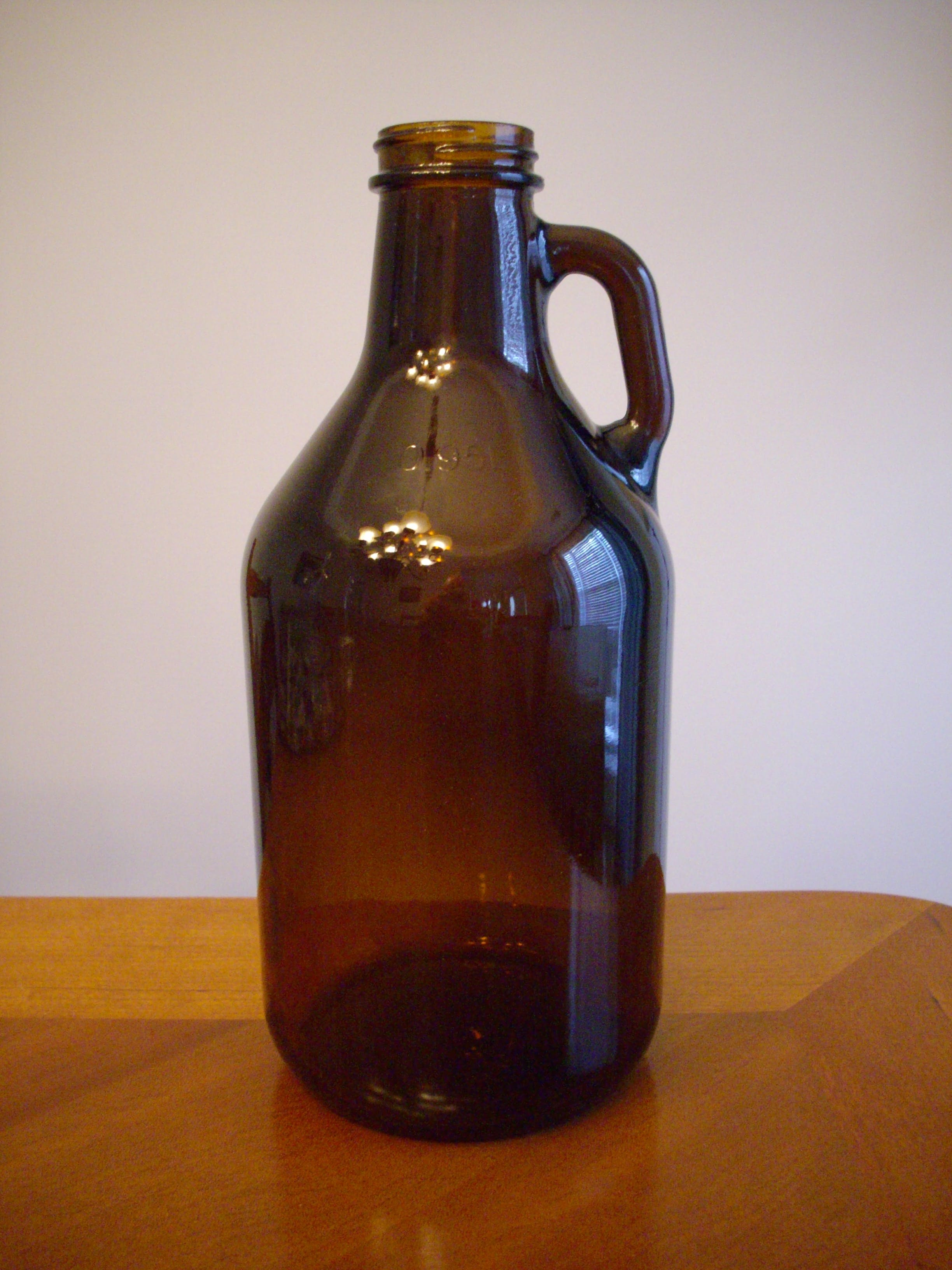 32 oz Amber Growler Growler sold by Wm. R. Hill & Company