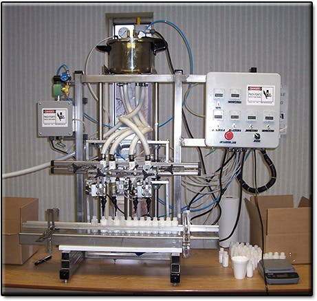 4 head Semi-automatic pressure/gravity filler Bottle filler sold by Neumann Packaging