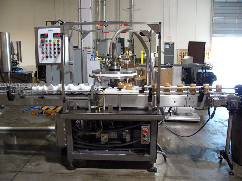 Versa-Fil High Speed Time/Pressure Filler Bottle filler sold by MRM Elgin - Cozzoli Machine Company