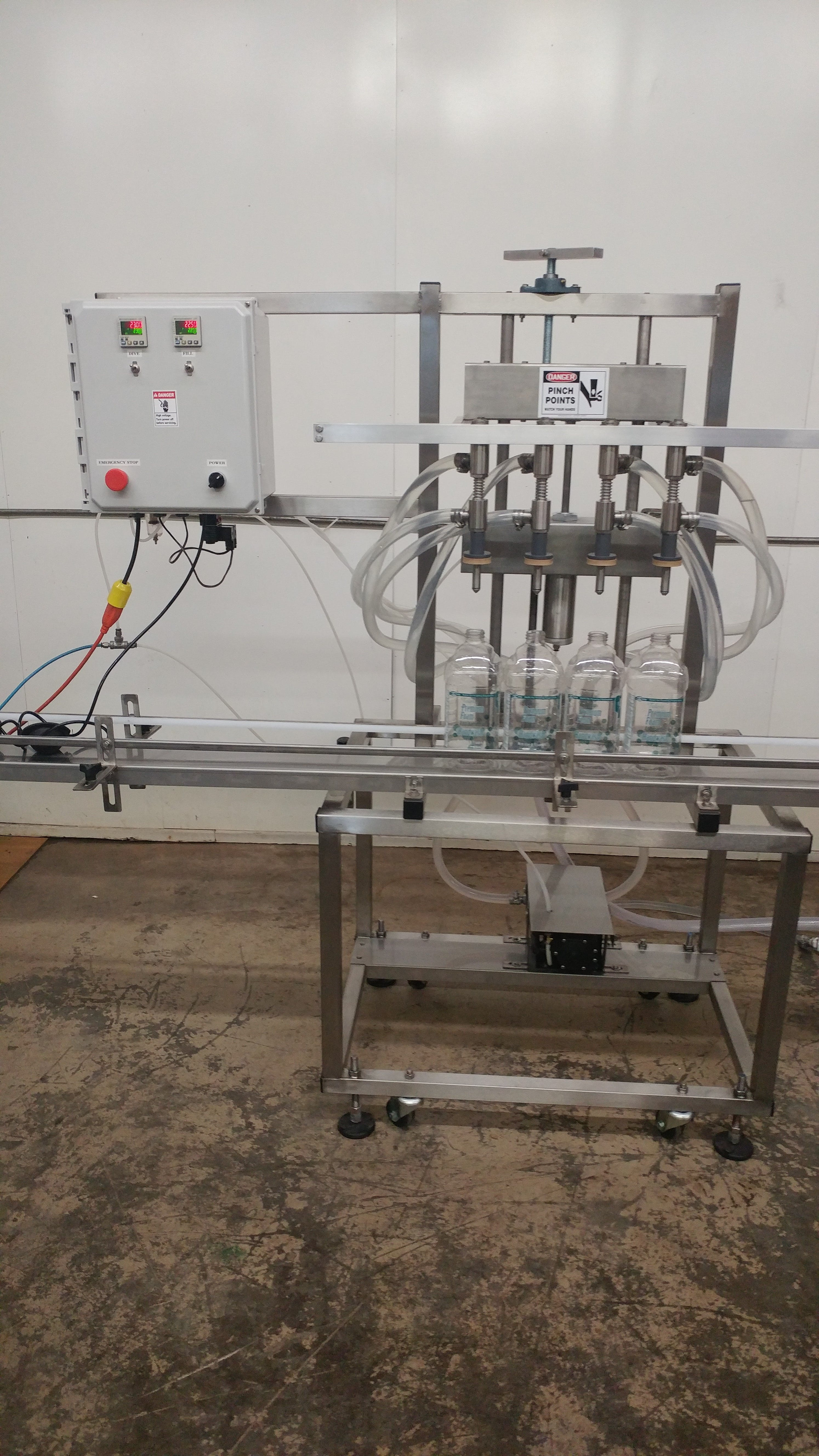 Four head overflow filling machine, mounted on a mobile chaise - sold by Neumann Packaging